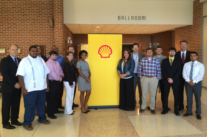 Students gathered around Shell poster